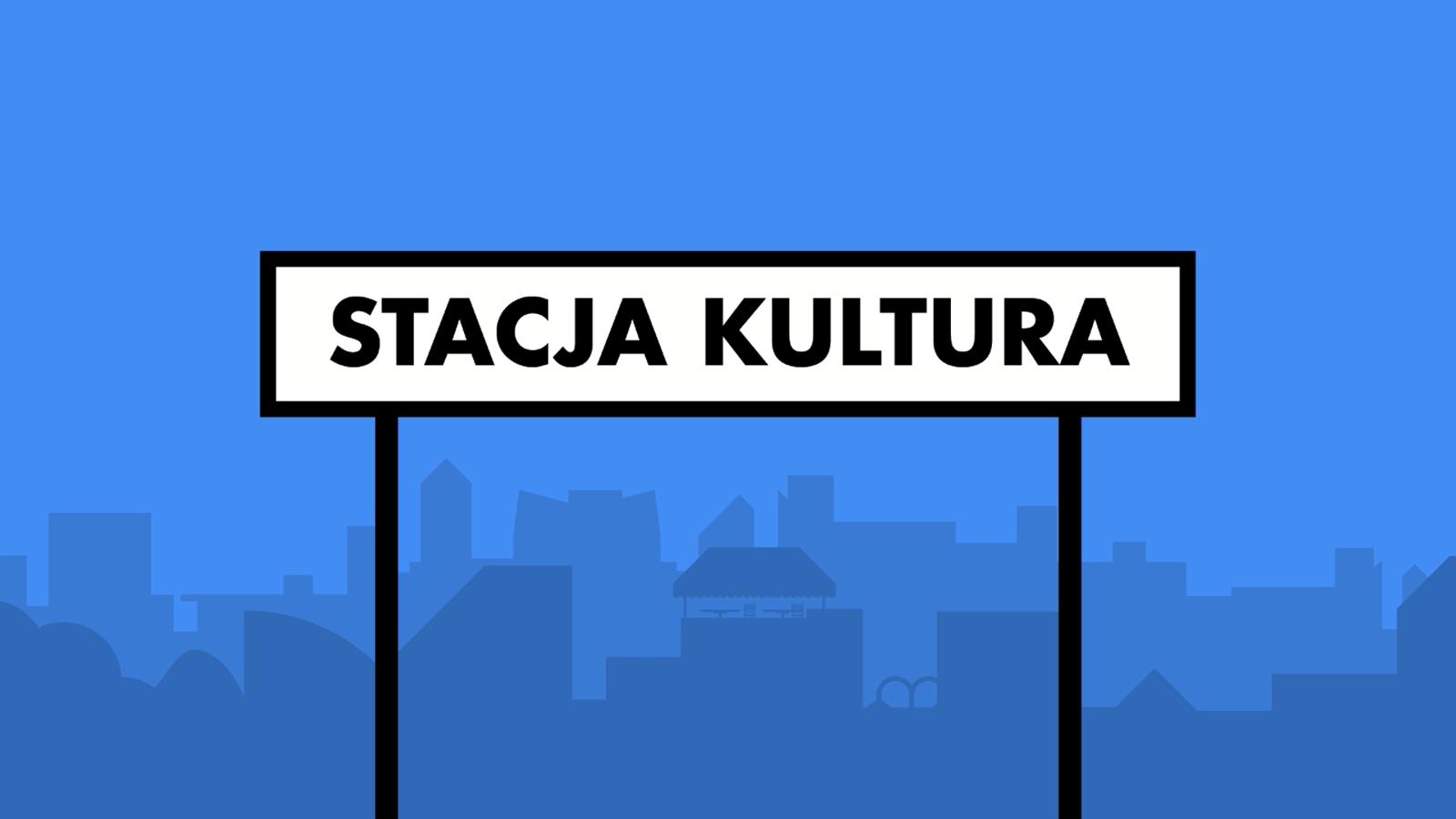 """Na znaku przypominającym znak stacji kolejowej napis """"Stacja kultura"""". W tle stylizowane niebieskie sylwetki budynków."""